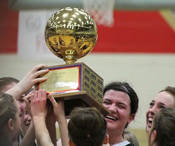 Sophomore Cosette Stellern and her teammates hoist the trophy after defeating Cheyenne Central, 54-37.