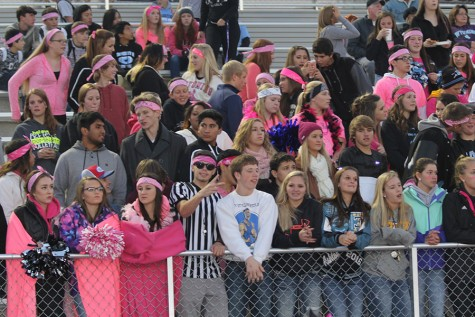 Led by their own referee, the T-Birds proudly sport pink in support of breast cancer awareness at the Evanston football game on October 15.