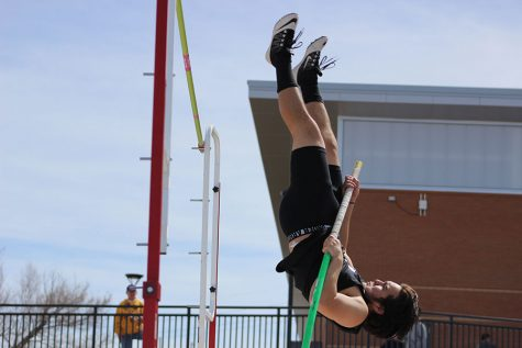 Junior Terrance Tatigue goes vertical in an attempt to clear one of the greater heights in the pole vault at the Okie Blanchard Meet.