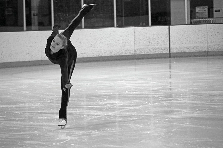 Senior Elizabeth Kassel etches up the ice while practicing her program for her final performance.