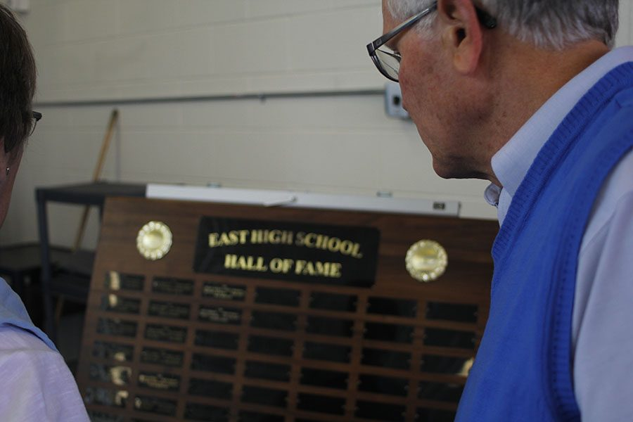 Ken Uhrich and his wife view the Hall of Fame plaque after the new inductees' names were added.