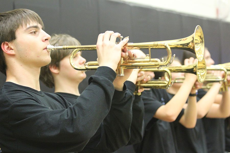 Junior Alexander Olson leads the trumpet section in