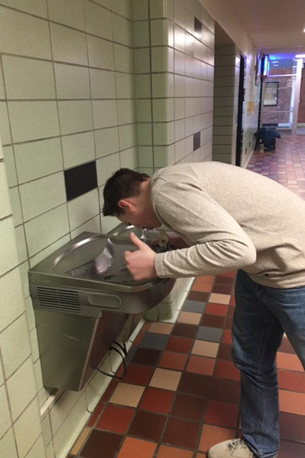 Sophomore Camden Schmidt drinks out of the number 1 ranked water fountain in East, the Tbird Nest Hallway Fountain.