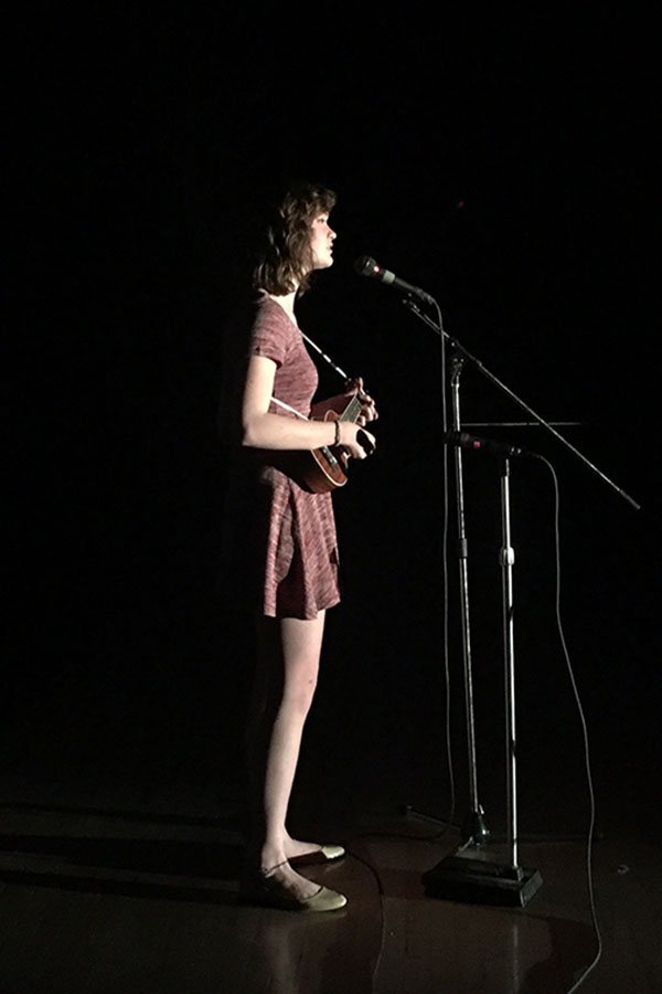 Junior Kenzie Merrit signing at the East Talent Show. Kenzie played her original song
