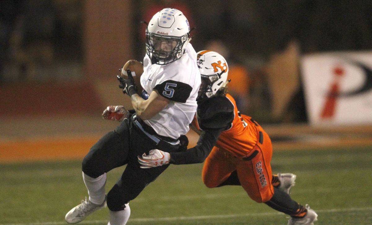 Senior Vance Nagy attempts to outrun a Natrona County Mustang during the semi final playoff game on November 3.