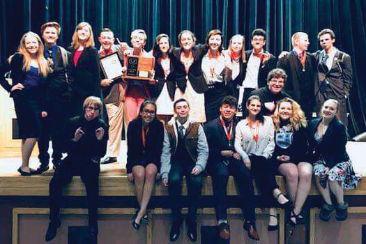East Speech and Debate shows off their trophies at the end of the State competition in Lander.