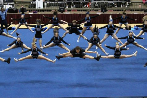 Led by senior Zak Whisenhunt, the EHS cheer team does a group jump during their Co-Ed routine at the WHSAA State Spirit competition. The T-Birds placed third.